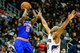 Nov 13, 2013; Atlanta, GA, USA; New York Knicks shooting guard Tim Hardaway Jr. (5) shoots a basket over Atlanta Hawks center Al Horford (15) in the first half at Philips Arena. Mandatory Credit: Daniel Shirey-USA TODAY Sports
