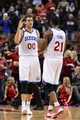 Nov 13, 2013; Philadelphia, PA, USA; Philadelphia 76ers center Spencer Hawes (00) celebrates with forward Thaddeus Young (21) during overtime against the Houston Rockets at Wells Fargo Center. The Sixers defeated the Rockets 123-117. Mandatory Credit: Howard Smith-USA TODAY Sports