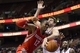 Nov 13, 2013; Philadelphia, PA, USA; Philadelphia 76ers center Spencer Hawes (00) blocks the shot of Houston Rockets forward Dwight Howard (12) during the fourth quarter at Wells Fargo Center. The Sixers defeated the Rockets 123-117. Mandatory Credit: Howard Smith-USA TODAY Sports