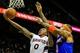 Nov 13, 2013; Atlanta, GA, USA; Atlanta Hawks point guard Jeff Teague (0) shoots a basket past New York Knicks power forward Kenyon Martin (3) in the second half at Philips Arena. The Knicks won 95-91. Mandatory Credit: Daniel Shirey-USA TODAY Sports