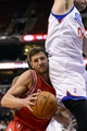 Nov 13, 2013; Philadelphia, PA, USA; Houston Rockets forward Chandler Parsons (25) is fouled by Philadelphia 76ers center Spencer Hawes (00) during the fourth quarter at Wells Fargo Center. The Sixers defeated the Rockets 123-117. Mandatory Credit: Howard Smith-USA TODAY Sports