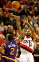 Nov 13, 2013; Portland, OR, USA; Portland Trail Blazers point guard Mo Williams (25) shoots over Phoenix Suns point guard Eric Bledsoe (2) at the Moda Center. Mandatory Credit: Craig Mitchelldyer-USA TODAY Sports