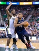 Nov 13, 2013; Salt Lake City, UT, USA; New Orleans Pelicans shooting guard Eric Gordon (10) is defended by Utah Jazz power forward Derrick Favors (15) during the second half at EnergySolutions Arena. The Jazz won 111-105. Mandatory Credit: Russ Isabella-USA TODAY Sports
