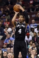 Nov 11, 2013; Philadelphia, PA, USA; San Antonio Spurs guard Danny Green (4) shoots a jump shot during the third quarter against the Philadelphia 76ers at Wells Fargo Center. The Spurs defeated the Sixers 109-85. Mandatory Credit: Howard Smith-USA TODAY Sports