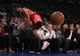 Nov 14, 2013; New York, NY, USA; Houston Rockets small forward Omri Casspi (18) dives into the stands for a loose ball against the New York Knicks during the fourth quarter of a game at Madison Square Garden. The Rockets beat the Knicks 109-106. Mandatory Credit: Brad Penner-USA TODAY Sports