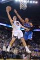 November 14, 2013; Oakland, CA, USA; Golden State Warriors shooting guard Klay Thompson (11) shoots the ball against Oklahoma City Thunder point guard Russell Westbrook (0) during the fourth quarter at Oracle Arena. The Warriors defeated the Thunder 116-115. Mandatory Credit: Kyle Terada-USA TODAY Sports
