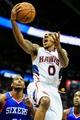 Nov 15, 2013; Atlanta, GA, USA; Atlanta Hawks point guard Jeff Teague (0) shoots a basket in the second half against the Philadelphia 76ers at Philips Arena. The Hawks won 113-103. Mandatory Credit: Daniel Shirey-USA TODAY Sports