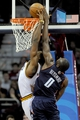 Nov 15, 2013; Cleveland, OH, USA; Charlotte Bobcats center Bismack Biyombo (0) tries to block the dunk of Cleveland Cavaliers power forward Tristan Thompson (13) during the third quarter at Quicken Loans Arena. The Bobcats beat the Cavaliers 86-80. Mandatory Credit: Ken Blaze-USA TODAY Sports