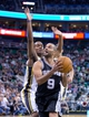 Nov 15, 2013; Salt Lake City, UT, USA; San Antonio Spurs point guard Tony Parker (9) looks to shoot while defended by Utah Jazz point guard Alec Burks (10) during the second half at EnergySolutions Arena. San Antonio won 91-82. Mandatory Credit: Russ Isabella-USA TODAY Sports