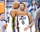 Nov 15, 2013; Salt Lake City, UT, USA; Utah Jazz small forward Richard Jefferson (24) and guard Diante Garrett (8) react during the second half against the San Antonio Spurs at EnergySolutions Arena. San Antonio won 91-82. Mandatory Credit: Russ Isabella-USA TODAY Sports