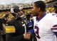 Nov 10, 2013; Pittsburgh, PA, USA; Pittsburgh Steelers quarterback Ben Roethlisberger (7) and Buffalo Bills quarterback EJ Manuel (3) meet at mid-field after their game at Heinz Field.  The Steelers won 23-10. Mandatory Credit: Charles LeClaire-USA TODAY Sports