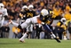 Nov 9, 2013; Morgantown, WV, USA; West Virginia Mountaineers wide receiver Kevin White (11) runs with the ball during the game against the Texas Longhorns at Milan Puskar Stadium. Mandatory Credit: Evan Habeeb-USA TODAY Sports