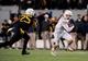 Nov 9, 2013; Morgantown, WV, USA; Texas Longhorns wide receiver Jaxon Shipley (8) runs with the ball in front of West Virginia Mountaineers safety Darwin Cook (25) at Milan Puskar Stadium. Mandatory Credit: Evan Habeeb-USA TODAY Sports