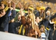 Nov 9, 2013; Morgantown, WV, USA; The West Virginia Mountaineers mascot high fives fans during the game against the Texas Longhorns at Milan Puskar Stadium. Mandatory Credit: Evan Habeeb-USA TODAY Sports