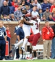 Nov 16, 2013; Oxford, MS, USA; Mississippi Rebels wide receiver Donte Moncrief (12) catches a pass thrown against Troy Trojans cornerback Ethan Davis (34) during the first half at Vaught-Hemingway Stadium. Mandatory Credit: Justin Ford-USA TODAY Sports