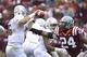 Nov 16, 2013; Blacksburg, VA, USA; Maryland Terrapins quarterback C.J. Brown (16) looks to pass as Virginia Tech Hokies linebacker Tariq Edwards (24) pressures in the first quarter at Lane Stadium. Mandatory Credit: Bob Donnan-USA TODAY Sports