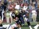 Nov 16, 2013; Foxborough, MA, USA; Massachusetts Minutemen defensive lineman Justin Anderson (50) tackles Akron Zips running back Conor Hundley (34) during the first half at Gillette Stadium. Mandatory Credit: Bob DeChiara-USA TODAY Sports
