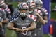 Nov 16, 2013; Evanston, IL, USA; Northwestern Wildcats wide receiver Tony Jones (6) wears the wounded warrior uniform before the game against the Michigan Wolverines at Ryan Field. Mandatory Credit: David Banks-USA TODAY Sports