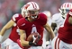 Nov 16, 2013; Madison, WI, USA; Wisconsin Badgers wide receiver Jared Abbrederis (4) rushes for a touchdown during the third quarter against the Indiana Hoosiers at Camp Randall Stadium. Mandatory Credit: Jeff Hanisch-USA TODAY Sports