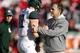 Nov 16, 2013; Lincoln, NE, USA; Michigan State Spartans head coach Mark Dantonio talks to quarterback Connor Cook (18) prior to the game against the Nebraska Cornhuskers at Memorial Stadium. Mandatory Credit: Bruce Thorson-USA TODAY Sports