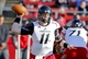 Nov 16, 2013; Piscataway, NJ, USA;  Cincinnati Bearcats quarterback Brendon Kay (11) throws pass during the second half against the Rutgers Scarlet Knights at High Points Solutions Stadium. Cincinnati Bearcats defeat the Rutgers Scarlet Knights 52-17. Mandatory Credit: Jim O'Connor-USA TODAY Sports