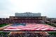 Nov 16, 2013; Champaign, IL, USA;  An American Flag covers the field during halftime in a salute to veterans during the game between the Ohio State Buckeyes and Illinois Fighting Illini at Memorial Stadium. Mandatory Credit: Bradley Leeb-USA TODAY Sports
