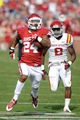 Nov 16, 2013; Norman, OK, USA; Oklahoma Sooners running back Brennan Clay (24) runs the ball while being pursued by Iowa State cyclones Jansen Watson (2) in the second half at Gaylord Family - Oklahoma Memorial Stadium. Mandatory Credit: Mark D. Smith-USA TODAY Sports