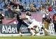 Nov 16, 2013; Foxborough, MA, USA; Akron Zips running back Jawon Chisholm (7) scores a touchdown past Massachusetts Minutemen defensive back Devin Brown (10) during the second half at Gillette Stadium. Mandatory Credit: Bob DeChiara-USA TODAY Sports