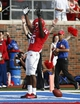 Nov 16, 2013; Dallas, TX, USA; Southern Methodist Mustangs wide receiver Jeremy Johnson (15) celebrates his touchdown against the Connecticut Huskies during the first half on an NCAA football game at Gerald J. Ford Stadium. Mandatory Credit: Jim Cowsert-USA TODAY Sports