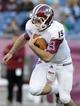 Nov 16, 2013; Foxborough, MA, USA; Massachusetts Minutemen quarterback A.J. Doyle (15) runs with the ball during the second half against the Akron Zips at Gillette Stadium. Mandatory Credit: Bob DeChiara-USA TODAY Sports