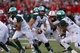 Nov 16, 2013; Lincoln, NE, USA; Michigan State Spartans quarterback Conner Cook (18) hands off to running back Jeremy Langford (33) Nebraska Cornhuskers in the second quarter at Memorial Stadium. Mandatory Credit: Bruce Thorson-USA TODAY Sports