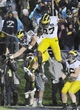 Nov 16, 2013; Evanston, IL, USA; Michigan Wolverines tight end Jake Butt (88) celebrates his touchdown catch in the first overtime with  tight end Devin Funchess (87)  against the Northwestern Wildcats at Ryan Field. The Michigan Wolverines defeated the Northwestern Wildcats 27-19 in triple overtime. Mandatory Credit: David Banks-USA TODAY Sports