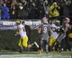 Nov 16, 2013; Evanston, IL, USA; Michigan Wolverines wide receiver Jonathan Keizer (89) catches a touchdown pass in the first overtime against the Northwestern Wildcats at Ryan Field. The Michigan Wolverines defeated the Northwestern Wildcats 27-19 in triple overtime. Mandatory Credit: David Banks-USA TODAY Sports