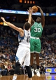Nov 16, 2013; Minneapolis, MN, USA; Boston Celtics power forward Brandon Bass (30) goes up for a shot over Minnesota Timberwolves power forward Kevin Love (42) in the first half at Target Center. Mandatory Credit: Jesse Johnson-USA TODAY Sports