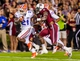 Nov 16, 2013; Columbia, SC, USA; Florida Gators running back Kelvin Taylor (21) breaks the tackle of South Carolina Gamecocks safety Chaz Elder (17) on the way to a touchdown in the second quarter at Williams-Brice Stadium. Mandatory Credit: Jeff Blake-USA TODAY Sports