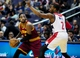 Nov 16, 2013; Washington, DC, USA; Cleveland Cavaliers guard Kyrie Irving (left) is guarded by Washington Wizards guard John Wall (right) at Verizon Center. Mandatory Credit: Evan Habeeb-USA TODAY Sports