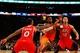Nov 16, 2013; New York, NY, USA;  New York Knicks shooting guard Iman Shumpert (21) drives between Atlanta Hawks shooting guard John Jenkins (12) and point guard Jeff Teague (0) during the third quarter at Madison Square Garden. Atlanta Hawks won 110-90.  Mandatory Credit: Anthony Gruppuso-USA TODAY Sports