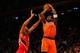 Nov 16, 2013; New York, NY, USA;  New York Knicks power forward Amar'e Stoudemire (1) shoots over Atlanta Hawks power forward Mike Scott (32) during the fourth quarter at Madison Square Garden. Atlanta Hawks won 110-90.  Mandatory Credit: Anthony Gruppuso-USA TODAY Sports
