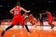 Nov 16, 2013; New York, NY, USA;  New York Knicks small forward Carmelo Anthony (7) drives between Atlanta Hawks defense during the fourth quarter at Madison Square Garden. Atlanta Hawks won 110-90.  Mandatory Credit: Anthony Gruppuso-USA TODAY Sports