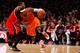 Nov 16, 2013; New York, NY, USA;  New York Knicks small forward Carmelo Anthony (7) drives past Atlanta Hawks power forward Paul Millsap (4) during the third quarter at Madison Square Garden. Atlanta Hawks won 110-90.  Mandatory Credit: Anthony Gruppuso-USA TODAY Sports