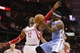 Nov 16, 2013; Houston, TX, USA; Denver Nuggets guard Ty Lawson (3) passes the ball around against Houston Rockets center Dwight Howard (12) during the second half at Toyota Center. The Rockets won 122-111. Mandatory Credit: Soobum Im-USA TODAY Sports