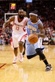 Nov 16, 2013; Houston, TX, USA; Denver Nuggets guard Ty Lawson (3) drives to the basket past Houston Rockets guard James Harden (13) during the second half at Toyota Center. The Rockets won 122-111. Mandatory Credit: Soobum Im-USA TODAY Sports