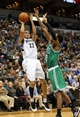 Nov 16, 2013; Minneapolis, MN, USA; Minnesota Timberwolves shooting guard Kevin Martin (23) goes up for a shot over Boston Celtics shooting guard MarShon Brooks (12) in the second half at Target Center. The TImberwolves won 106-88. Mandatory Credit: Jesse Johnson-USA TODAY Sports