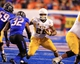 Nov 16, 2013; Boise, ID, USA; Wyoming Cowboys running back Tedder Easton (22) is meet in the hole Boise State Broncos linebacker Jonathan Brown (32) during first half of play verses the Boise State Broncos at Bronco Stadium. Mandatory Credit: Brian Losness-USA TODAY Sports