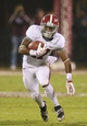 Nov 16, 2013; Starkville, MS, USA; Alabama Crimson Tide running back Kenyan Drake (17) advances the ball during the game against the Mississippi State Bulldogs at Davis Wade Stadium. Alabama Crimson Tide defeat the Mississippi State Bulldogs with a score of 20-7.  Mandatory Credit: Spruce Derden-USA TODAY Sports