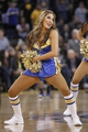 Nov 16, 2013; Oakland, CA, USA; A Golden State Warriors dancer performs during a timeout against the Utah Jazz in the third quarter at Oracle Arena. The Warriors defeated the Jazz 102-88. Mandatory Credit: Cary Edmondson-USA TODAY Sports