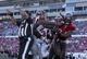 Nov 17, 2013; Tampa, FL, USA; Atlanta Falcons tackle Lamar Holmes (76) pushes Tampa Bay Buccaneers defensive end Adrian Clayborn (94) after Atlanta Falcons scored a touchdown during the second half at Raymond James Stadium. Tampa Bay Buccaneers defeated the Atlanta Falcons 41-28. Mandatory Credit: Kim Klement-USA TODAY Sports