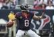 Nov 17, 2013; Houston, TX, USA; Houston Texans quarterback Matt Schaub (8) attempts a pass during the third quarter against the Oakland Raiders at Reliant Stadium. The Raiders defeated the Texans 28-23. Mandatory Credit: Troy Taormina-USA TODAY Sports
