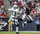 Nov 17, 2013; Houston, TX, USA; Houston Texans wide receiver Andre Johnson (80) makes a reception during the fourth quarter as Oakland Raiders cornerback Tracy Porter (23) defends at Reliant Stadium. Mandatory Credit: Troy Taormina-USA TODAY Sports