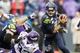 Nov 17, 2013; Seattle, WA, USA; Seattle Seahawks quarterback Russell Wilson (3) scrambles away from pressure by the Minnesota Vikings during the fourth quarter at CenturyLink Field. Mandatory Credit: Joe Nicholson-USA TODAY Sports